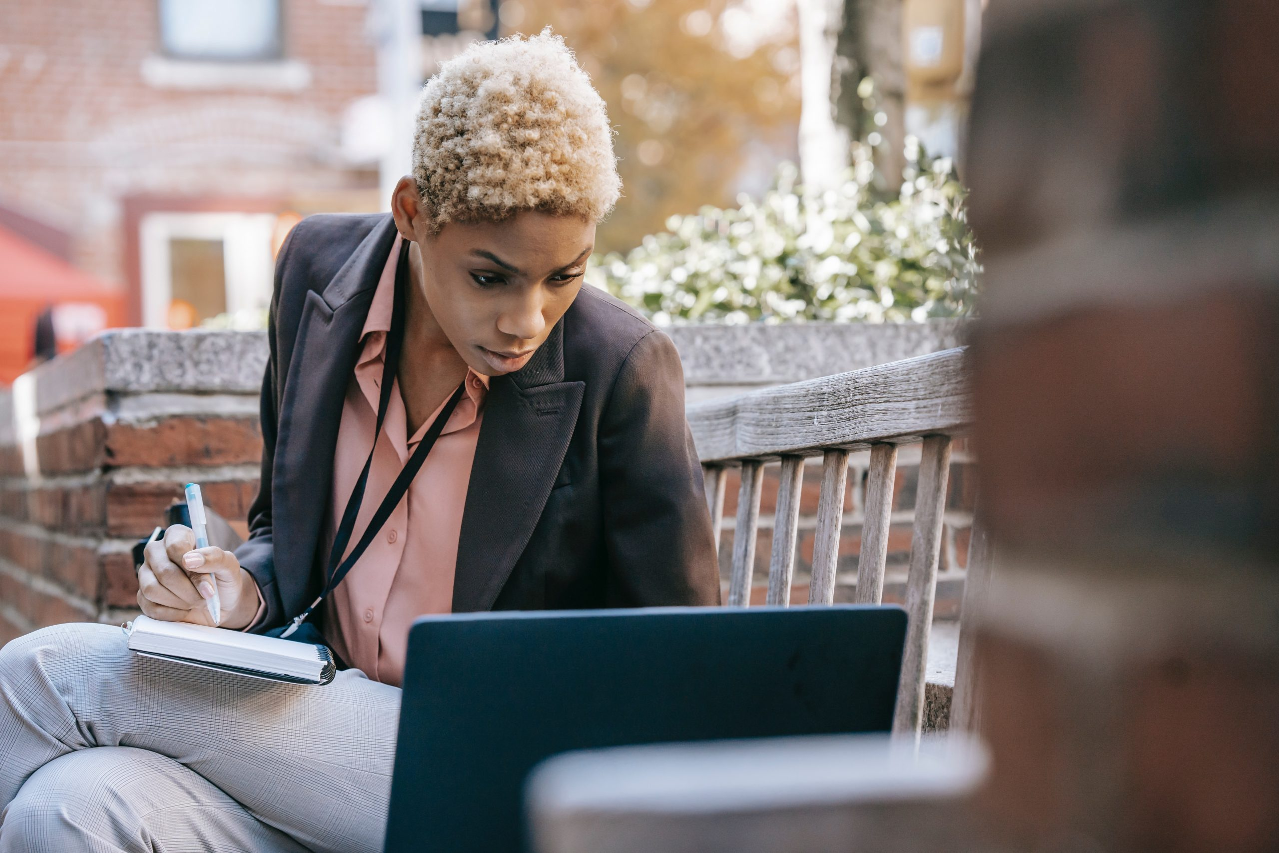 Woman taking notes online studying